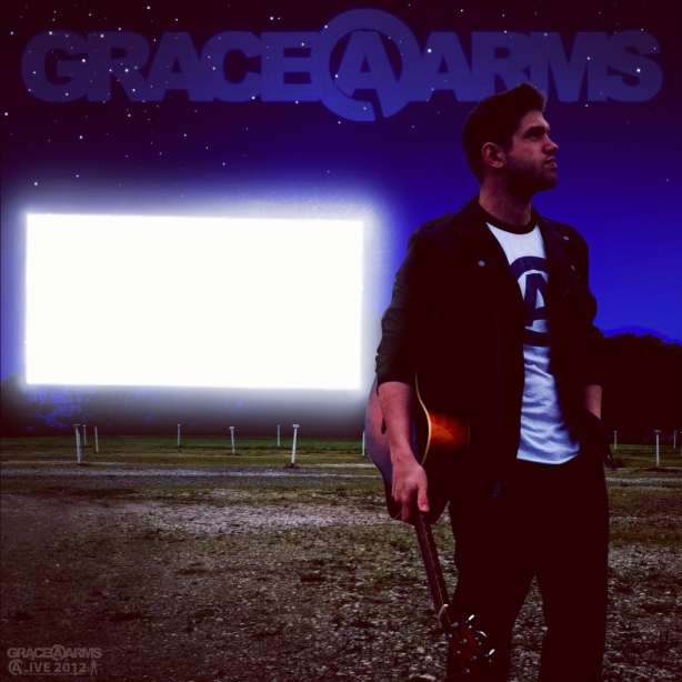 A poster of Bastion Crider of Grace at Arms (GRACE@ARMS) in front of the movie screen at the Skyvue Drive-In in New Castle, Indiana.  All art, logos, and design by Bastion, copyright Grace at Arms, Bastion Crider, and Greg Crider LLC.