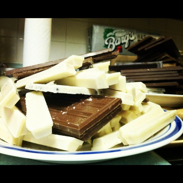 Two heaps of chocolate candy bars leftover from Bastion's Chocolate Piano.  Photo by Bastion Crider of Grace at Arms (GRACE@ARMS), 2012.