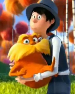 The Lorax and the Once-ler, arm in arm in a screen capture from the movie adaptation of Dr. Seuss' The Lorax, cropped by Bastion Crider of Grace at Arms (GRACE@ARMS).